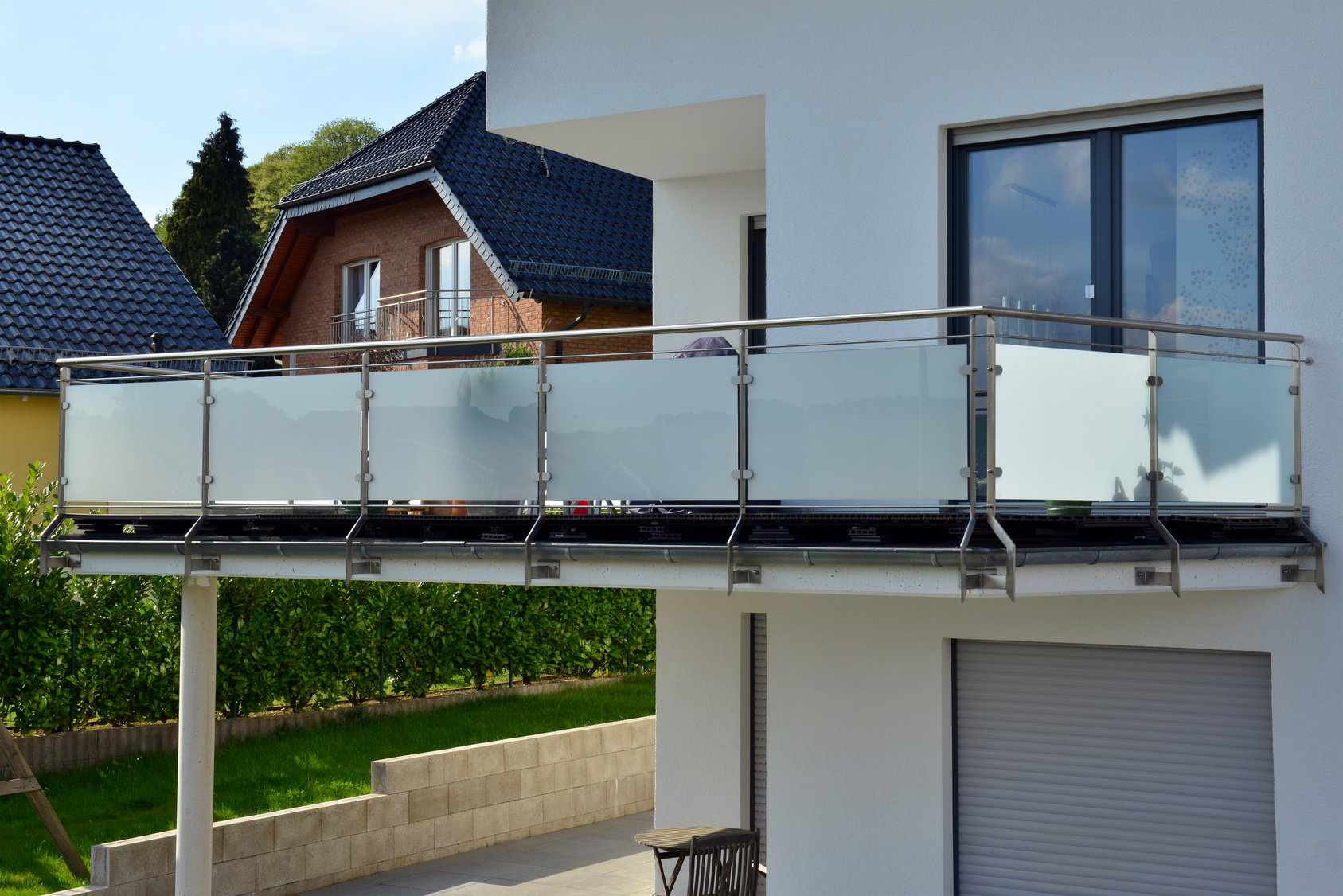 Modern balcony with steel railing separated with glass panels