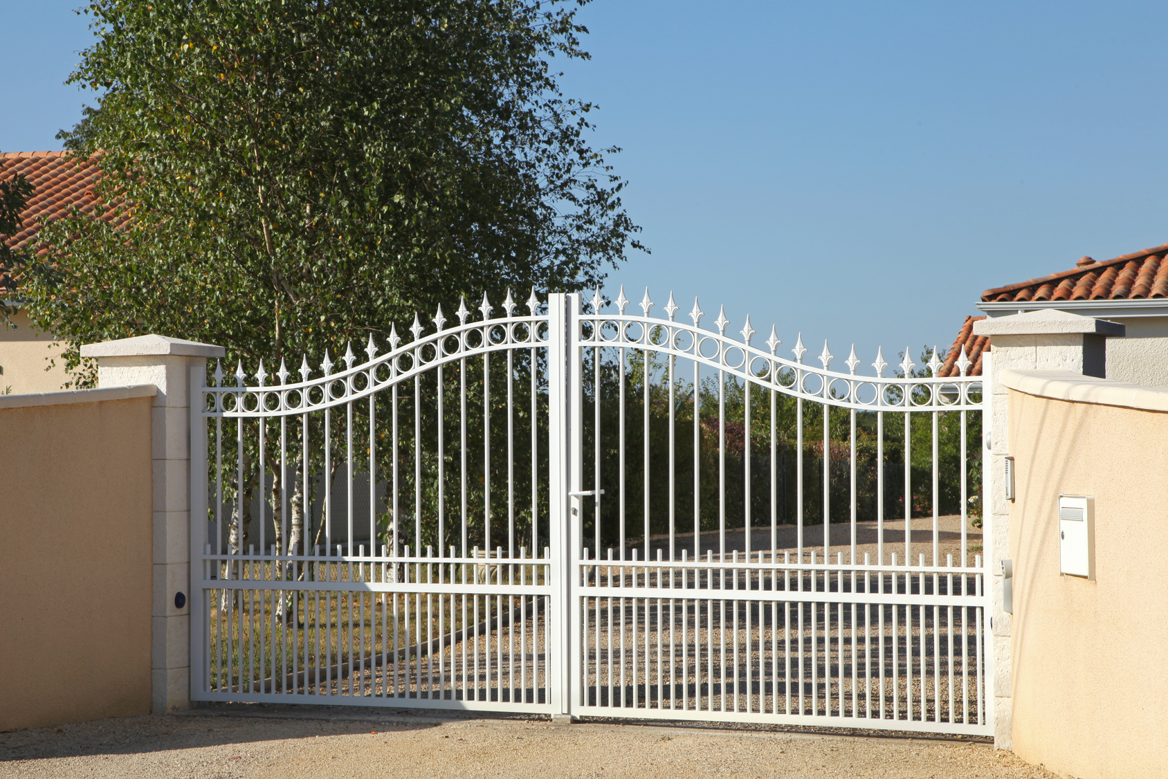 White metal gate on driveway
